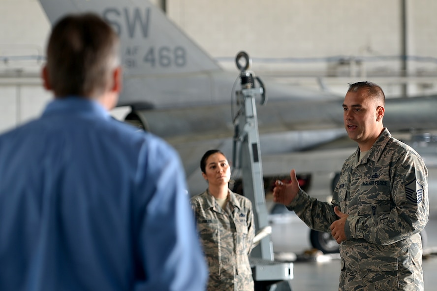 U.S Air Force Master Sgt. Christopher Benton, 20th Maintenance Group weapons academic instructor, speaks with members of the Shaw-Sumter Community Council (SSCC) during a tour at Shaw Air Force Base, South Carolina, Nov. 2, 2017.