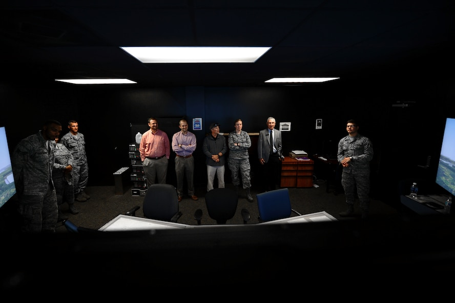 U.S. Airmen assigned to the 20th Fighter Wing and members of the Shaw-Sumter Community Council (SSCC) watch a flightline simulator at the 20th Operations Support Squadron air traffic control tower at Shaw Air Force Base, South Carolina, Nov. 2, 2017.