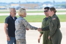 Brig. Gen. Heather Pringle, 502nd Air Base Wing, Joint Base San Antonio commander, speaks with the Royal Canadian aircrew pilot Capt. Daniel Ebisuzaki (second from right) and U.S. Air Force pilot Maj. Kimberley Sercel (right) of a CC-130J Hercules and Mr. Salvador Flores, Air Terminal Operations Chief (left), at Joint Base San Antonio-Lackland Kelly Field, Texas carrying humanitarian supplies from the government of Canada to aid in Hurricane Harvey relief efforts Sept. 3, 2017. The supplies included pediatric necessities like baby formula, blankets, cribs and other similar items. The RCAF airlift flew in from 8 Wing Trenton, Ontario. (U.S. Air Force photo by Andrew C. Patterson)