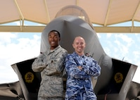 Airman 1st Class Alex Akers, 61st Aircraft Maintenance Unit crew chief (left), and Cpl Jeff Forder, 61st AMU Australian crew chief, stand in front of an F-35A Lightning II at Luke Air Force Base, Ariz., Sept. 14, 2017. This year marks the 100th anniversary of the Australia-U.S. partnership. (U.S. Air Force photo/Senior Airman James Hensley)