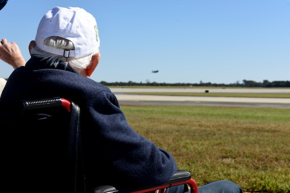 Andrew Whipple, Korean War veteran, watches as an F-15E Strike Eagle takes off across the runway, Oct. 27, 2017, at Seymour Johnson Air Force Base, North Carolina. The Strike Eagle is a dual-role fighter designed to perform air-to-air and air-to-ground missions. (U.S. Air Force Photo by Airman 1st Class Miranda A. Loera)