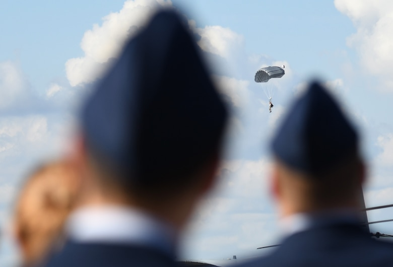 Mississippi high school Junior ROTC drill teams watch 334th Training Squadron battlefield Airmen conduct a parachute demonstration during the Fourth Annual Mississippi All-Services Junior ROTC Drill Competition Nov. 4, 2017, on Keesler Air Force Base, Mississippi. More than 400 Junior ROTC cadets, spectators and volunteers were in attendance where cadets battled for the best all-services Junior ROTC team in Mississippi. Thirteen Junior ROTC teams from all military branches were represented at the event with the Pearl High School Navy Junior ROTC earning the top honors. (U.S. Air Force photo by Kemberly Groue)