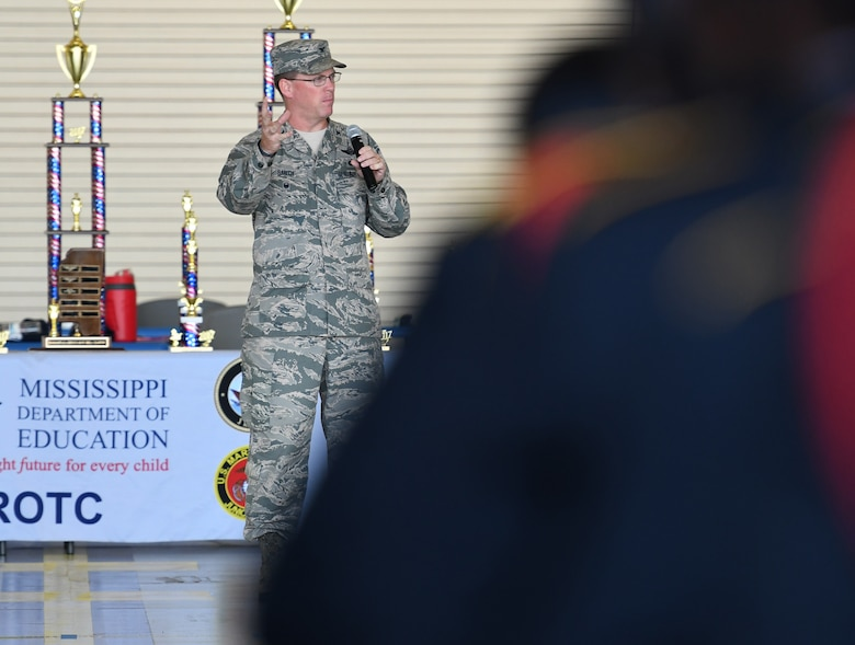 Col. C. Mike Smith, 81st Training Wing vice commander, delivers closing remarks during the Fourth Annual Mississippi All-Services Junior ROTC Drill Competition Nov. 4, 2017, on Keesler Air Force Base, Mississippi. More than 400 Junior ROTC cadets, spectators and volunteers were in attendance where cadets battled for the best all-services Junior ROTC team in Mississippi. Thirteen Junior ROTC teams from all military branches were represented at the event with the Pearl High School Navy Junior ROTC earning the top honors. (U.S. Air Force photo by Kemberly Groue)