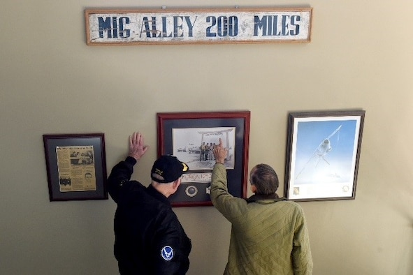 Max Garland (left), Korean War veteran, views a picture of a MiG Alley sign from the Korean War, Oct. 26, 2017, at Seymour Johnson Air Force Base, North Carolina. MiG Alley was the name given by the United Nations pilots to the northwestern portion of North Korea during the Korean War.  (U.S. Air Force Photo by Airman 1st Class Miranda A. Loera)