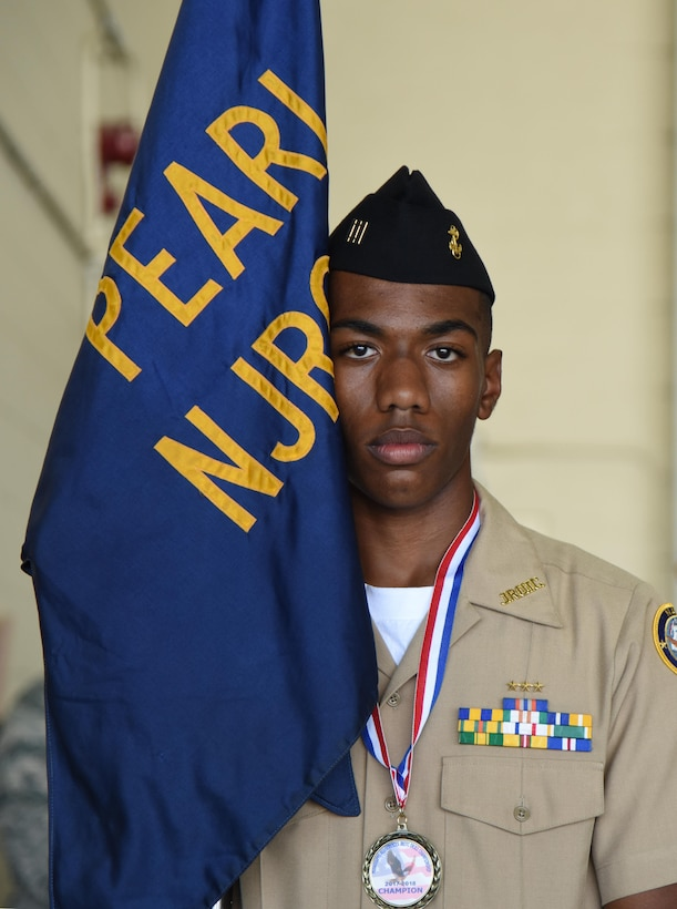 Jalen Houseworth, Pearl High School Navy Junior ROTC  posts the guidon during the Fourth Annual Mississippi All-Services Junior ROTC Drill Competition Nov. 4, 2017, on Keesler Air Force Base, Mississippi. More than 400 Junior ROTC cadets, spectators and volunteers were in attendance where cadets battled for the best all-services Junior ROTC team in Mississippi. Thirteen Junior ROTC teams from all military branches were represented at the event with the Pearl High School Navy Junior ROTC earning the top honors. (U.S. Air Force photo by Kemberly Groue)