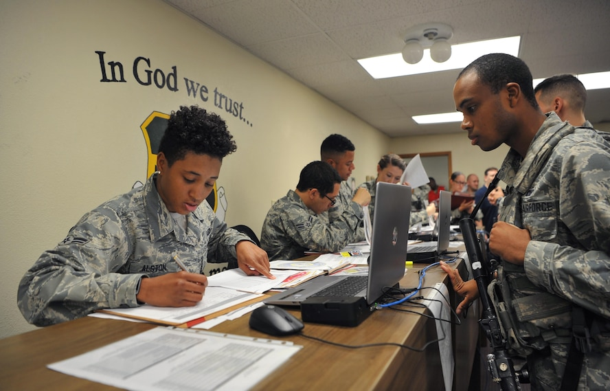 9th Force Support Squadron personnel out-process a group of Airmen during Global Thunder 18