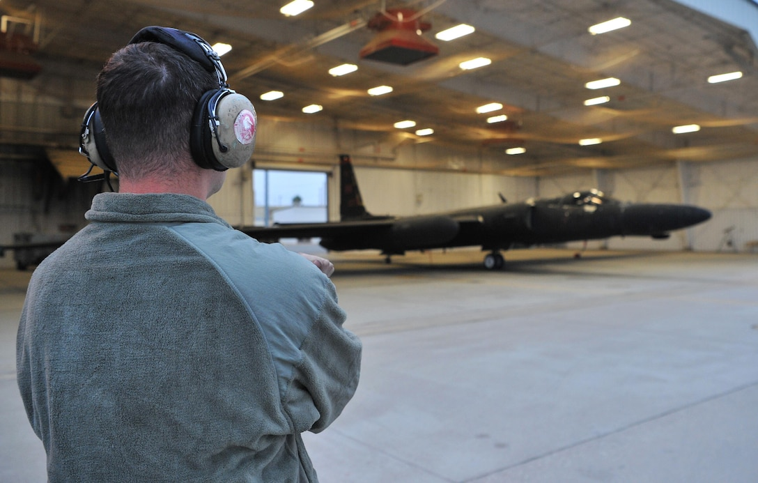 A 9th Aircraft Maintenance Squadron Airman prepares a U-2 Dragon Lady for takeoff in a hangar during Global Thunder 18,