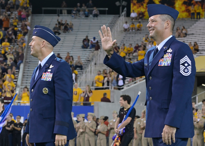 Brig. Gen. Brook Leonard, 56th Fighter Wing commander, and Chief Master Sgt. Randy Kwiatkowski, 56th FW command chief, are recognized during Arizona State University's annual Salute to Service football game in Tempe, Ariz., Nov. 4, 2017. The Salute to Service initiative honors military members past and present for their sacrifices to our country by hosting service themed events. (U.S. Air Force photo/Senior Airman Devante Williams)