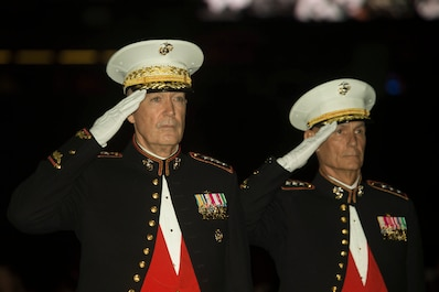 Gen. Joseph F. Dunford Jr. (left), the Chairman of Joint Chiefs of Staff and Lt. Gen. Rex C. McMillian (right), Commander of Marine Forces Reserve and Marine Forces North render honors to the colors during the Marine Forces Reserve birthday ball ceremony, Nov. 3, 2017.