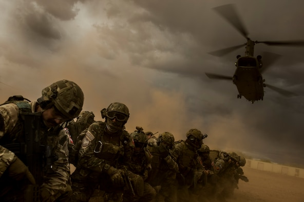 U.S. Air Force and coalition forces cover themselves as a CH-47 Chinook helicopter takes off at Florence, Ariz., during Angel Thunder 17, May 9, 2017. Angel Thunder is a two-week, Air Combat Command-sponsored, joint certified and accredited personnel recovery exercise focused on search and rescue. The exercise is designed to provide training for personnel recovery assets using a variety of scenarios to simulate deployment conditions and contingencies. (U.S. Air Force photo by Staff Sgt. Corey Hook)