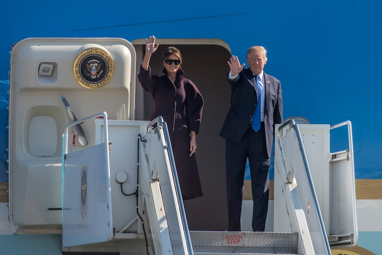 President Donald J. Trump and First Lady Melania wave goodbye to media and service members prior to boarding Air Force One, Nov. 7, 2017, at Yokota Air Base, Japan.