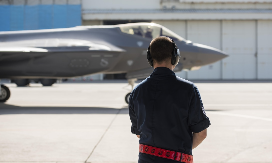 U.S. Air Force Staff Sgt. Zachary Kasperek, 34th Aircraft Maintenance Unit F-35A Lightning II crewchief, watches an F-35A  taxi for take-off at Kadena Air Base, Japan, Nov. 7, 2017. Approximately 300 Airmen and 12 F-35As from Hill Air Force Base, Utah's 388th and 419th Fighter Wings are deployed to Kadena AB for a six-month planned rotation.  (U.S. Air Force photo by Senior Airman Omari Bernard)