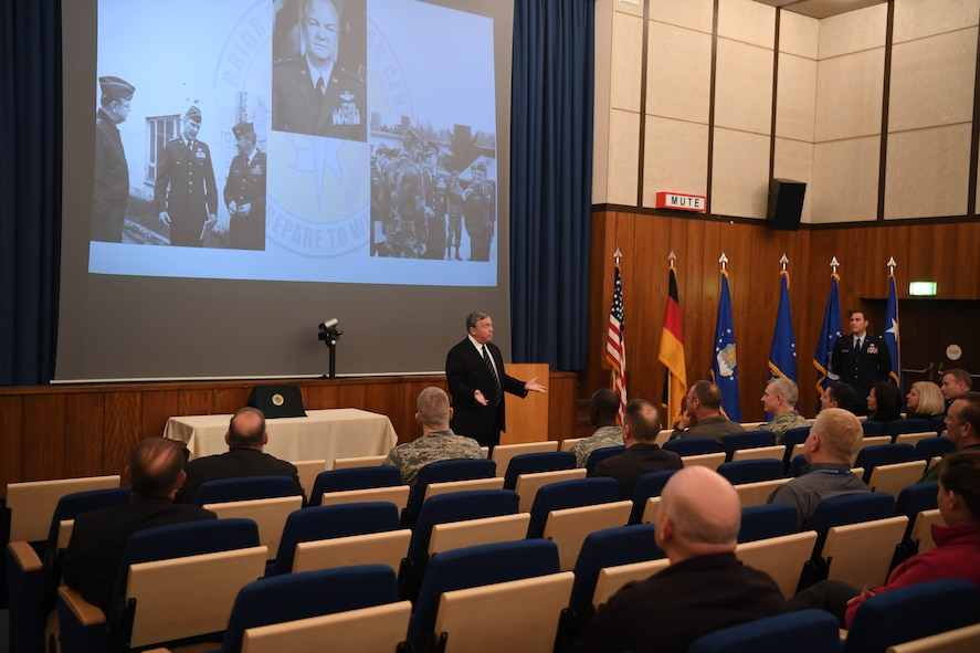 "James ""Snake"" Clark, Director, Intelligence, Surveillance and Reconnaissance Modernization and Infrastructure, speaks about Gen. William Kirk during the WPC Kirk Theater dedication ceremony Nov. 6, 2017, Einsiedlerhof Air Station, Germany. With the approval from Kirk, the U.S. Air Forces in Europe director of operations in 1982, Col. Richard ""Moody"" Suter founded the Warrior Preparation Center as a simulation center, which focused initially on air defense and electronic warfare. (U.S. Air Force photo by Staff Sgt. Rachelle Coleman)"