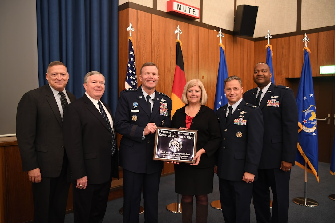 U.S. Air Force Gen. Tod D. Wolters, U.S. Air Forces in Europe-Air Forces Africa commander, presents Karen Bennett, daughter of Gen. William L. Kirk, with a plaque naming the Warrior Preparation Center Theater in honor of her father and his efforts to establish the WPC, Nov. 6, 2017, Einsiedlerhof Air Station, Germany. Kirk and his team founded the WPC to give USAFE forces the tactical advantage over adversaries in the Cold War era. (U.S. Air Force photo by Staff Sgt. Rachelle Coleman)