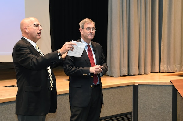 Todd Saylor (left), chief of innovation and development for U.S. Strategic Command (USSTRATCOM) thanks retired U.S. Air Force Gen. Stephen Lorenz for sharing his perspective on leadership with members of USSTRATCOM at Offutt Air Force Base, Neb., Nov. 6, 2017. Lorenz, who retired as commander of Air Education and Training Command, discussed the traits and practices of effective leaders based on his experience as a military officer and commander.