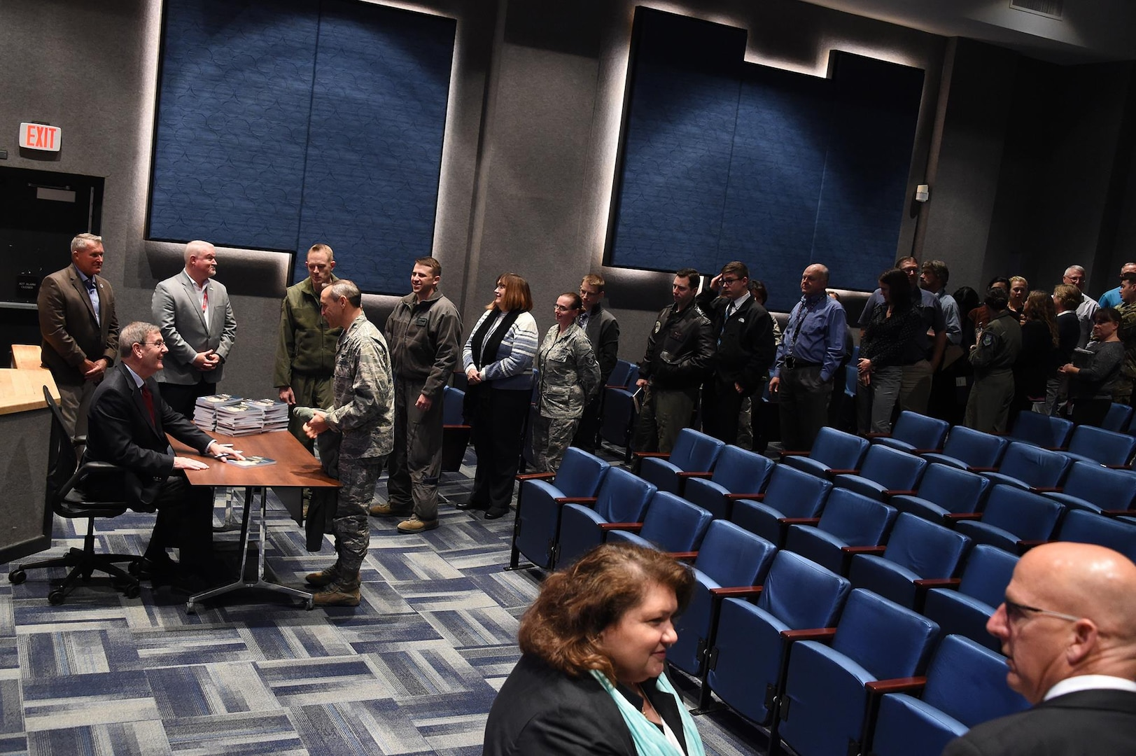 Retired U.S. Air Force Gen. Stephen Lorenz signs copies of his book, titled Lorenz on Leadership, after his presentation to members of U.S. Strategic Command at Offutt Air Force Base, Neb., Nov. 6, 2017. Lorenz, who retired as commander of Air Education and Training Command, discussed the traits and practices of effective leaders based on his experience as a military officer and commander.