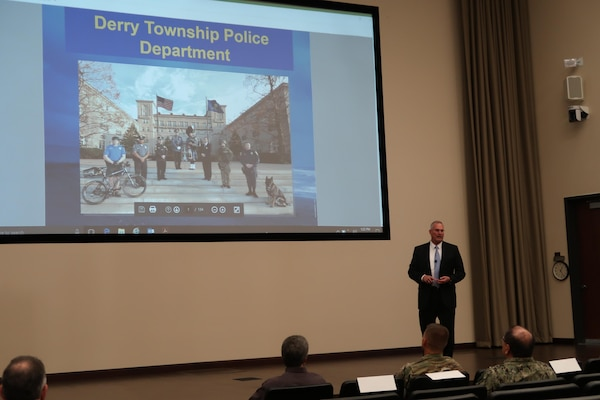 Patrick M. O'Rourke, Sr., former Derry Township police chief and current security manager with the Global Security team at the Hershey Company speaks during a force protection lecture series which highlighted photos of the 2011 flooding in Hershey, Pennsylvania, and the efforts of the Derry Township Police Department on Oct. 27 at DLA Distribution Susquehanna, Pennsylvania.