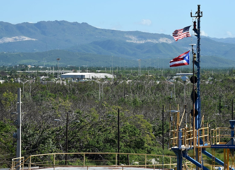 A U.S. flag and Puerto Rico flag fly high above the Port of Ponce, Puerto Rico, Nov. 3, 2017.