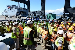 Carlos Vila, Southeastern Atlantic Detachment, 832nd Transportation Battalion, 597th Trans. Brigade marine cargo specialist, provides safety guidance to members of the 597th Trans. Bde., the Federal Emergency Management Agency, local dockworkers and other mission partners before unloading Military Sealift Command's USNS Brittin at the Port of Ponce, Puerto Rico, Nov. 3, 2017.