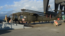 U.S. Navy Sailors assigned to U.S. Navy Cargo Handling Battalion One from Williamsburg, Va., and U.S. Army Soldiers from C Company, 2nd Battalion, 211th Aviation Regiment, Minnesota National Guard, unload a UH-60 Black Hawk medical evacuation helicopter from Military Sealift Command's USNS Brittin at the Port of Ponce, Puerto Rico, Nov. 3, 2017.