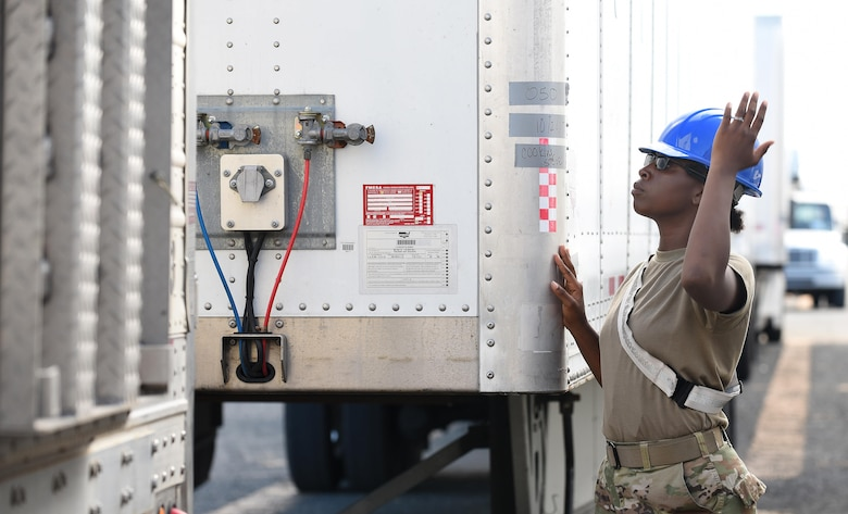 U.S. Army Specialist Adrianne Reese, cargo specialist from the 119th Inland Cargo Transfer Company, 11th Transportation Battalion, 7th Transportation Brigade (Expeditionary) based at Joint Base Langley-Eustis, Va., guides a 53-foot trailer into place on the shipyard of the Port of Ponce, Puerto Rico, Nov. 4, 2017.