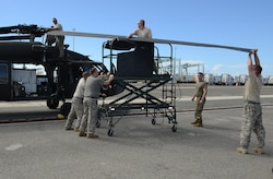 U.S. Army Soldiers from C Company, 2nd Battalion, 211th Aviation Regiment, Minnesota National Guard, prepare a UH-60 Black Hawk medical evacuation helicopter for use at the Port of Ponce, Puerto Rico, Nov. 4, 2017.
