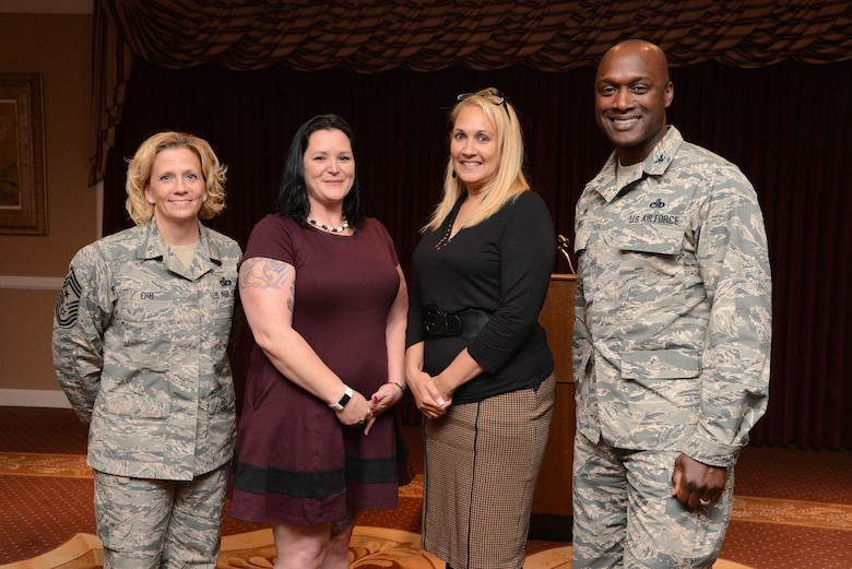 72nd Air Base Wing Command Chief Master Sgt. Melissa Erb, Domestic Abuse Victim Advocate Kaylee Anderson, Susan Still and 72nd Air Base Wing Commander Col. Kenyon Bell gather after a story-telling event for Domestic Violence Awareness Month featured Ms. Still and her account of her own harrowing experiences.