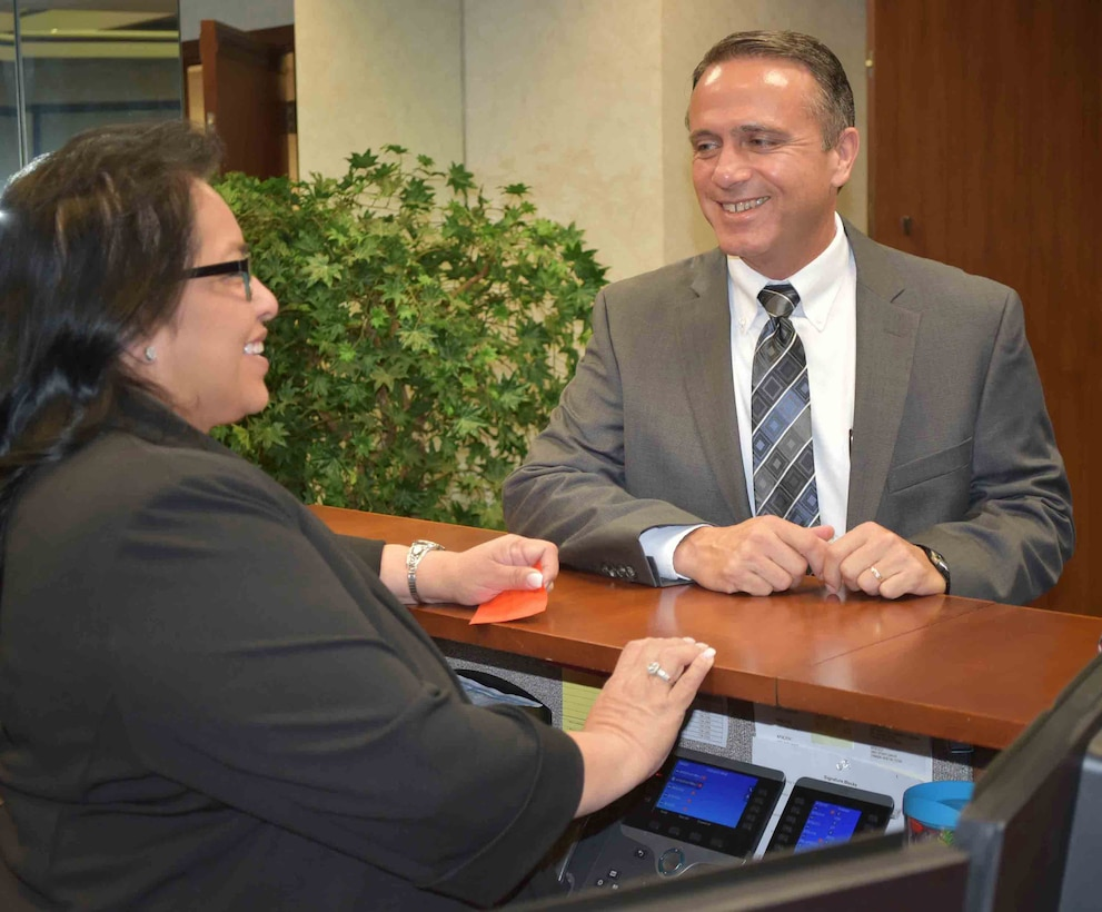 Kevin Stamey, Air Force Sustainment Center executive director, visits with his administrative assistant, Audrey Tilley, outside his new office in Bldg. 3001.