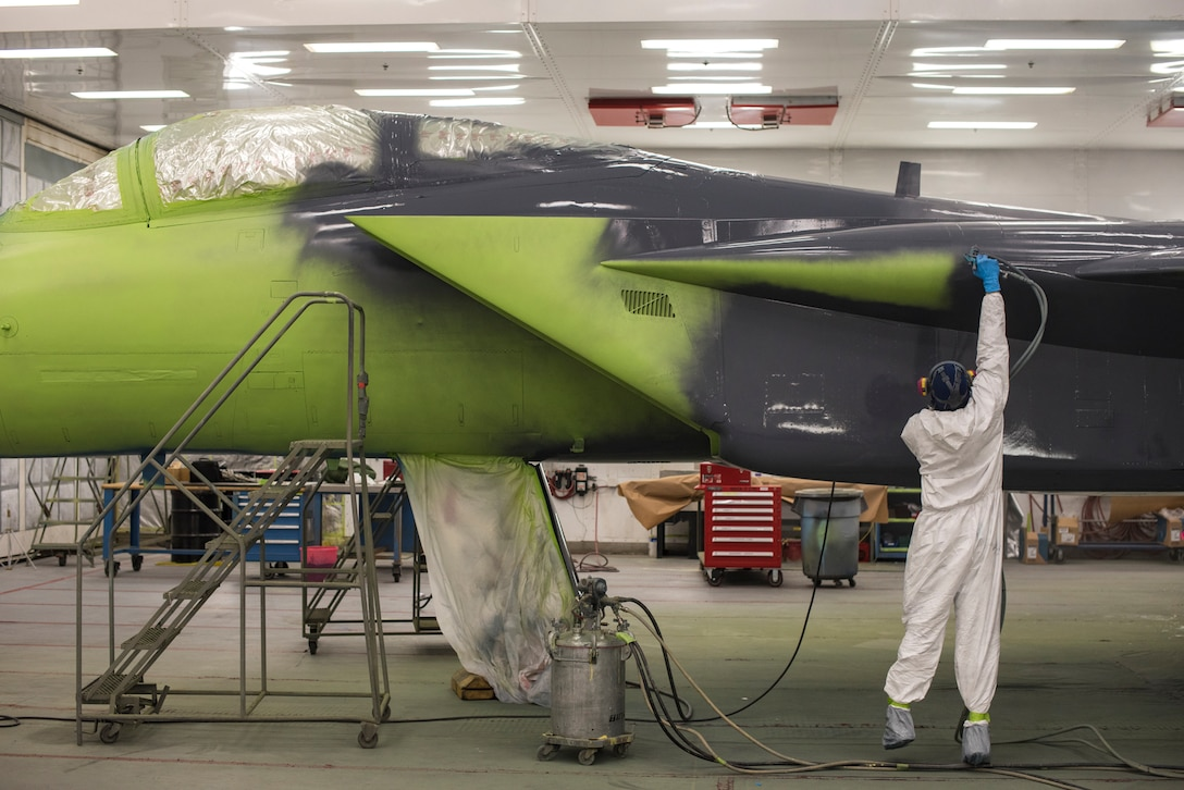 Michael Moore, 57th Maintenance Squadron aircraft painter, applies paint to an F-15C Eagle at Nellis Air Force Base, Nev., Oct. 25, 2017. The aircraft is being repainted to recognize the Air Force's 70th Anniversary as well as the unity between the Las Vegas community and Nellis AFB. (U.S. Air Force photo by Airman 1st Class Andrew D. Sarver/Released)