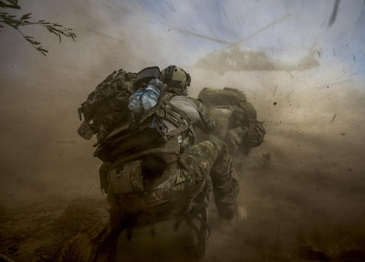 Pararescue airmen prepare a patient for helicopter transport.