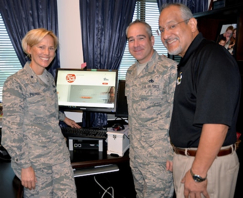 (From left) Brig. Gen. Heather Pringle, commander, 502nd Air Base Wing and Joint Base San Antonio; Chief Master Sgt. Kristopher Berg, command chief, 502nd ABW and JBSA; and Fil Jimenez, 502nd ABW technical director; look over the 2017 Combined Federal Campaign website at http://opm.gov/showsomelovecfc at the 502nd ABW headquarters at JBSA-Fort Sam Houston recently.