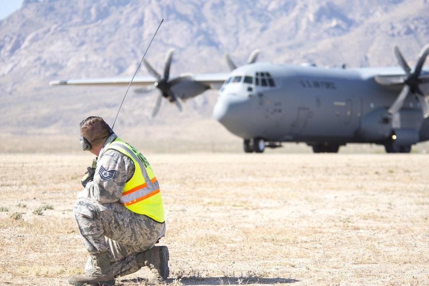 Tech. Sgt. Attila Csipes, 49th Logistics Readiness Squadron Small Air Terminal non commissioned officer in charge waits to launch out a C-130 Hercules from Little Rock Air Force Base, Ark., Oct. 31, 2017. Airmen from the 49th LRS offloaded equipment from the aircraft for Vigilant Shield 18 at White Sands Missile Range, N.M.  The equipment will be used by the 10th Mountain Division for their part of the exercise from Nov 1-9, 2017.  (U.S. Air Force photo by Tech. Sgt. Jeff Howerton)