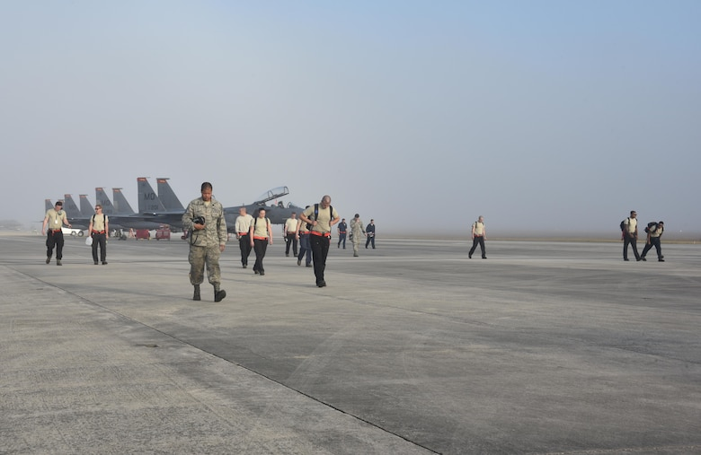 Airmen walking on flightline