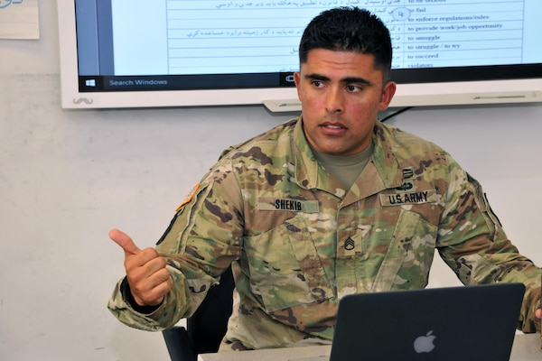 Staff Sgt. Mashal Shekib, a Military Language Instructor at the Defense Language Institute Foreign Language Center, Presidio of Monterey, California, teaches a Pashto class Nov. 3, 2017. Originally from Kabul, he immigrated to the U.S. in 2008 and enlisted in the U.S. Army in 2009. (U.S. Army photo by Patrick Bray/Released)