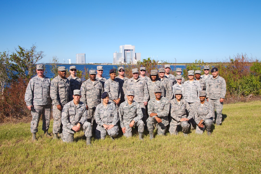 Officers and enlisted Airmen from the 45th Space Wing Mission Support Group pose for a photo during the 'Lunch & Launch' event, held Nov. 6 on the Eastern Range. The 'Lunch & Launch' program allowed company grade officers, noncommissioned officers and senior noncommissioned officers an opportunity to sit down, share a meal with leadership, and learn more from individuals outside their functional area they normally do not interact with. (U.S. Air Force photo by Staff Sgt. Christopher Stoltz)