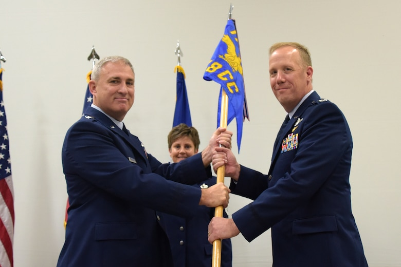 Col. Gregg Hesterman, the 178th Wing commander, assumes his new leadership position during a change of command ceremony at Springfield Air National Guard Base in Springfield, Ohio, Nov. 4, 2017. Maj. Gen. Stephen Markovich, the Ohio National Guard Commander for Air, passed the guidon to Hesterman. Col. John Knabel relinquished command and retired after 29 years of military service.