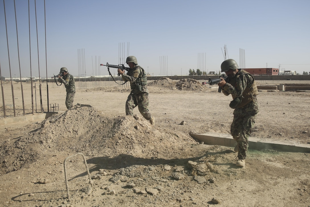 Afghan National Army soldiers with 6th Kandak, 1st Brigade, 215th Corps maneuver toward a notional enemy position during a platoon attack exercise at Camp Shorabak, Afghanistan, Nov. 6, 2017. The training was part of the operational readiness cycle, an eight-week course led by ANA instructors at the Helmand Regional Military Training Center. The curriculum focuses on developing the warfighting tactics and techniques of its students in order to support future combat operations against the Taliban throughout the province. (U.S. Marine Corps photo by Sgt. Lucas Hopkins)