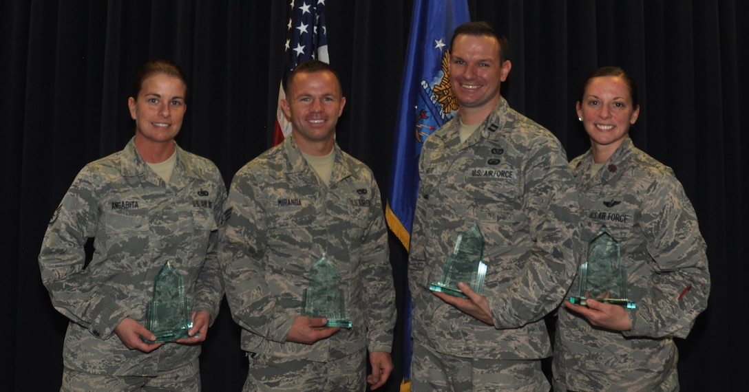 Reservists with the 302nd Airlift Wing who were recognized during the wing's third quarter awards ceremony pose for a photo Nov. 5, 2017 at Peterson Air Force Base, Colo., in the Summit Center.