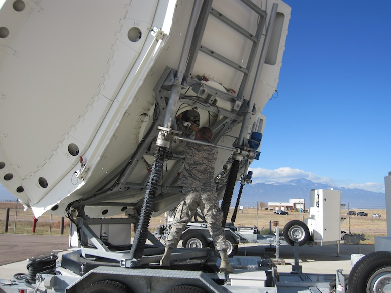 Tech Sgt. Robert Hicks, 16th SPCS flight chief and maintainer, makes adjustments on a piece of equipment Nov. 3, 2017, at Peterson Air Force Base, Colorado. The 16th SPCS uses such equipment to defend access to the space domain by identifying, characterizing, and geolocating specific signals broadcast from many sources. (Courtesy photo)