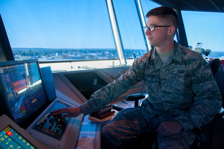 Airman 1st Class Tyler Boatman, air traffic controller journeyman, stands duty as local control in Wright-Patterson's air traffic control tower. Boatman's responsibities include clearing all aircraft for takeoff and landing, ensuring that proper space is left between all aircraft for safety. (U.S. Air Force photo/John Harrington)
