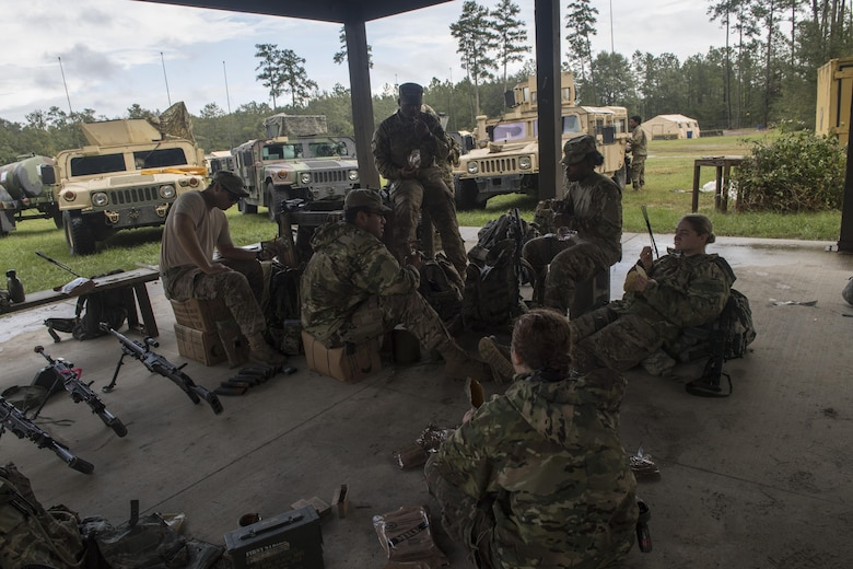 Airmen from the 823d Base Defense Squadron enjoy lunch during a mission readiness exercise, Oct. 23, 2017, at Moody Air Force Base, Ga. The 820th Base Defense Group tested the 823d BDS's ability to operate in an austere environment with challenging scenarios that tested their capabilities and effectiveness. (U.S. Air Force Senior Airman Janiqua P. Robinson)