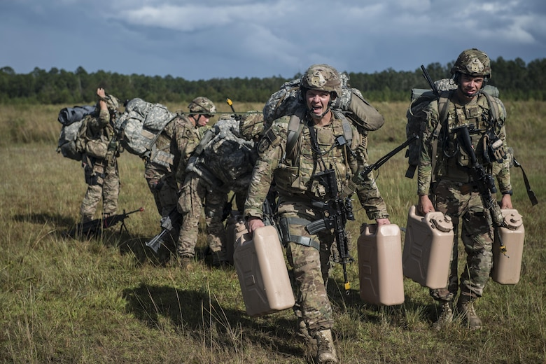 Airmen from the 823d Base Defense Squadron walk to their campsite during a mission readiness exercise, Oct. 23, 2017, at Moody Air Force Base, Ga. The 820th Base Defense Group tested the 823d BDS's ability to operate in an austere environment with challenging scenarios that tested their capabilities and effectiveness. (U.S. Air Force Senior Airman Janiqua P. Robinson)