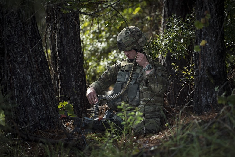 Senior Airman Johnathan Citsay, 823d Base Defense Squadron fireteam member, loads an M240B machine gun during a mission readiness exercise, Oct. 23, 2017, at Moody Air Force Base, Ga. The 820th Base Defense Group tested the 823d BDS's ability to operate in an austere environment with challenging scenarios that tested their capabilities and effectiveness. (U.S. Air Force Senior Airman Janiqua P. Robinson)