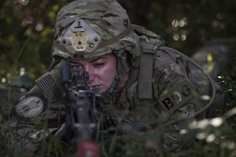 Airman 1st Class Breyana Williams, 823d Base Defense Squadron fireteam member, aims an M240B machine gun during a mission readiness exercise, Oct. 23, 2017, at Moody Air Force Base, Ga. The 820th Base Defense Group tested the 823d BDS's ability to operate in an austere environment with challenging scenarios that tested their capabilities and effectiveness. (U.S. Air Force Senior Airman Janiqua P. Robinson)