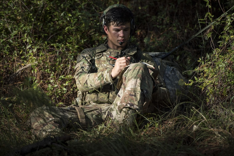 Airman 1st Class Mason Wiedrich, 823d Base Defense Squadron fireteam member, writes down field notes after a simulated ambush during a mission readiness exercise, Oct. 23, 2017, at Moody Air Force Base, Ga. The 820th Base Defense Group tested the 823d BDS's ability to operate in an austere environment with challenging scenarios that tested their capabilities and effectiveness. (U.S. Air Force Senior Airman Janiqua P. Robinson)