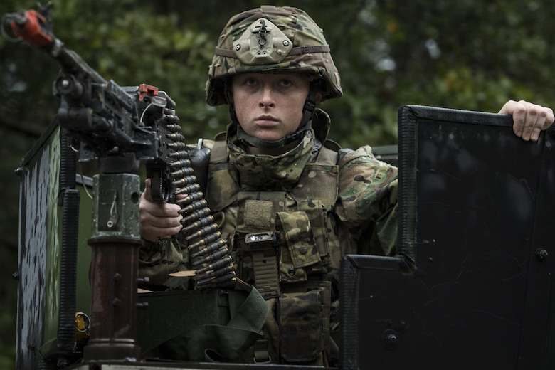 Airman 1st Class Haley Sahagan, 823d Base Defense Squadron fireteam member, watches for threats in the turret of a Humvee during a mission readiness exercise, Oct. 23, 2017, at Moody Air Force Base, Ga. The 820th Base Defense Group tested the 823d BDS's ability to operate in an austere environment with challenging scenarios that tested their capabilities and effectiveness. (U.S. Air Force Senior Airman Janiqua P. Robinson)