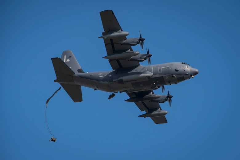 Airmen from the 820th Base Defense Group jump out of an HC-130J Combat King II, during a mission readiness exercise, Oct. 20, 2017, at Moody Air Force Base, Ga. The 820th BDG tested the 823d Base Defense Squadron's ability to operate in an austere environment with challenging scenarios that tested their capabilities and effectiveness. (U.S. Air Force Senior Airman Janiqua P. Robinson)