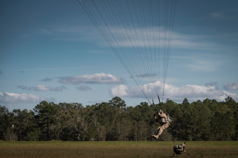 Master Sgt. Franz Bruce-Salmon, 823d Base Defense Squadron NCOIC of force protection intelligence, braces to land after jumping out of an HC-130J Combat King II, during a mission readiness exercise, Oct. 20, 2017, at Moody Air Force Base, Ga. The 820th Base Defense Group tested the 823d BDS's ability to operate in an austere environment with challenging scenarios that tested their capabilities and effectiveness. (U.S. Air Force Senior Airman Janiqua P. Robinson)