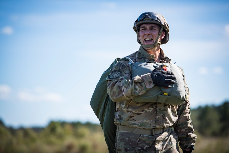 Staff Sgt. Kyle Henderson, 820th Combat Operations Squadron unit scheduler, yells after landing from an HC-130J Combat King II jump, during a mission readiness exercise, Oct. 20, 2017, at Moody Air Force Base, Ga. The 820th Base Defense Group tested the 823d Base Defense Squadron's ability to operate in an austere environment with challenging scenarios that tested their capabilities and effectiveness. (U.S. Air Force Senior Airman Janiqua P. Robinson)