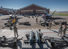 U.S. Air Force weapons load crew Airmen from the 94th and 27th Aircraft Maintenance Units, compete in the 3rd Quarter Weapons Load Competition at Joint Base Langley-Eustis, Va., Nov. 3, 2017. Load crews supporting the 94th and 27th Fighter Squadrons competed to be the best for the 3rd quarter. (U.S. Air Force photo by Staff Sgt. Carlin Leslie)